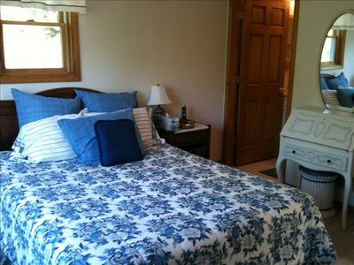 Walloon Lake house rental - Upstairs queen sized bedroom, ensuite bathroom though door on the right
