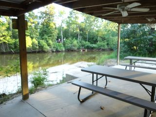 Pavilion w/ 2 picnic tables, charcoal grill, cover, benches at the water's edge - Gulfport house vacation rental photo