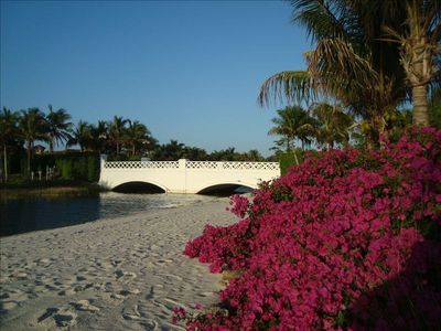 Walk the sandy Beaches of Miromar Lakes with scenic Bridges and Bougainvilleas