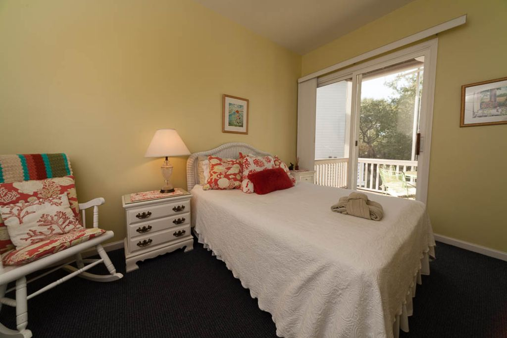 Downstairs bedroom with queen size bed and bathroom