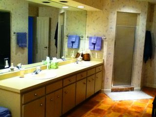 Boca Grande house photo - Spacious double vanity, dressing area and shower in private master bath.
