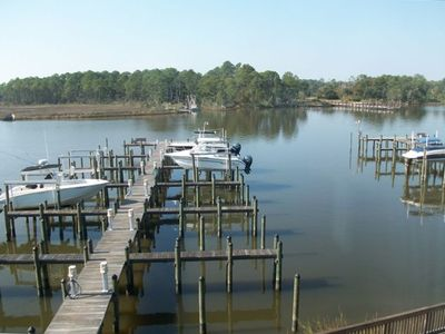Boat Slips and Fishing Pier-Lights, water & fish cleaning tables