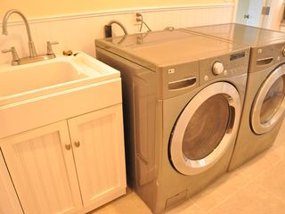 Anaheim house photo - Laundry room with top-of-the-line washer and dryer. Detergent provided.