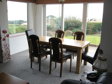 Diningplace with view of garden and sea