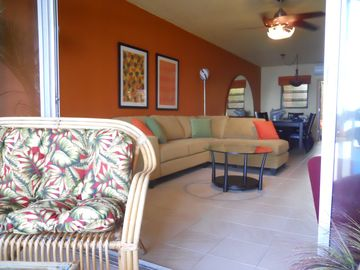 view from gallery (patio) to living room and dining area. DR table seats 6+