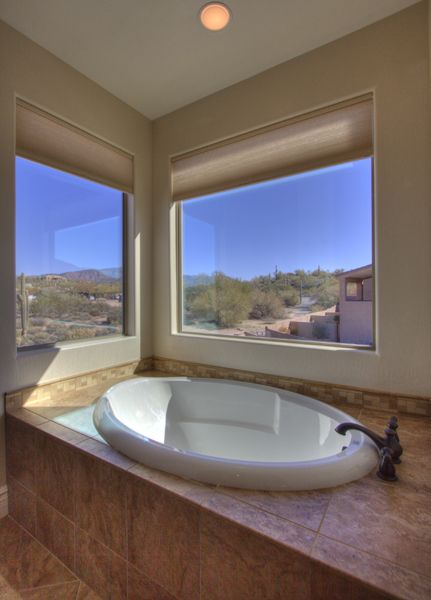 1st master bath, garden tub that overlooks the pool and north mountain views.