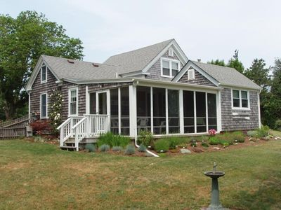 Front of cottage.  The screened in porch over looks the inlet/ocean view.