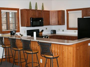 Kitchen and bar area; ski in for lunch or walk in from golf course for dinner