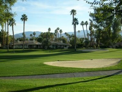 Palm Desert condo rental - Golf course view of mountains and swaying palm trees from south facing patio.