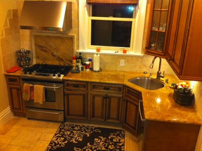 San Francisco apartment rental - Stunning wood cabinetry, granite countertops, and travertine stone floor.