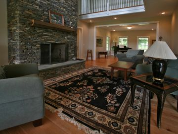 Living Room with Soaring Hand Laid Stone Fireplace