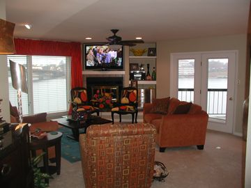 Hot Springs condo rental - Living room area overlooking Lake and main channel / Hwy 7 bridge