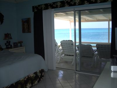 Deck w/turquoise sea off of very spacious mstr bdr, King bed, ceiling fan,TV,DVD
