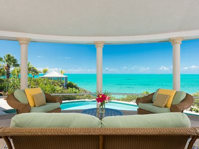 screened in family room overlooking wrap around pool and panoramic views