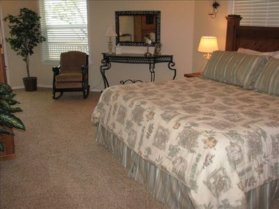 Spacious Master Bedroom upstairs with awesome lake view.