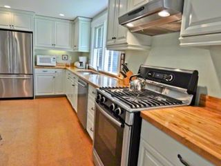 Vineyard Haven house photo - Large, Sunny Kitchen Is Well-Equipped For Vacation Entertaining With Stainless Appliances & Butcher Block Counters