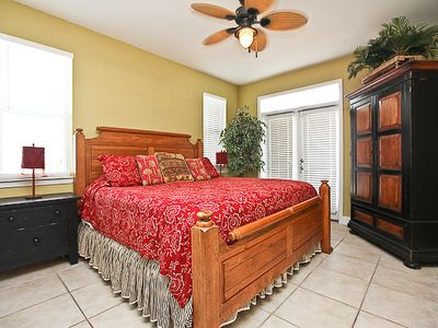 King master bedroom on 1st floor w/ full private bath and balcony with Gulf view