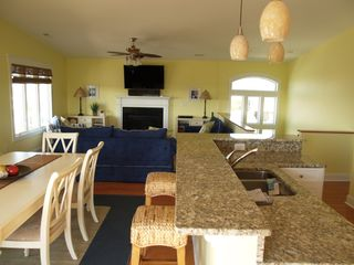 Oak Island house photo - Open Dining room , Kitchen, to Livingroom , upscale furnished