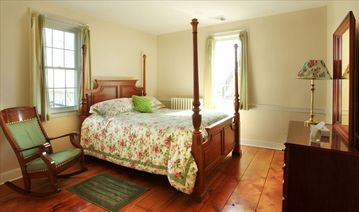 Country Breeze Room, with rocker for leisure relaxing, 1 Queen bed, and dresser.