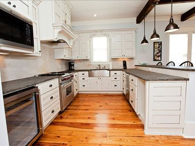 World class kitchen, unfinished granite counter tops, wine fridge, wolf stove.