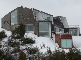 Bariloche house photo - House in winter, back view from below
