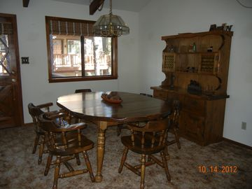 Dining area open to great room; seats 6 with 6 additional bar stools availabl...