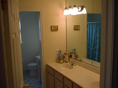 2nd Fl left hall bath (extra view of dual sinks before pocket privacy bath door.