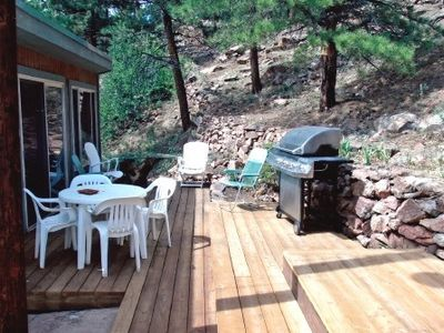 SPACIOUS DECK JUST OUTSIDE HOT TUB ROOM WITH GAS GRILL AND METAL FIRE PIT