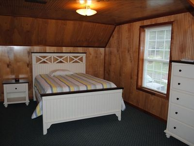 Upstairs bedroom with brand new queen bed and attached bath.