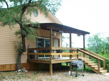 Wimberley cabin rental - Cabin front deck with barbeque pit