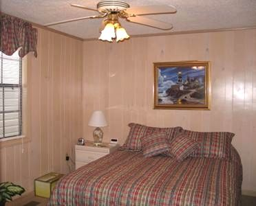 Master bedroom includes queen size bed and TV with expanded cable.