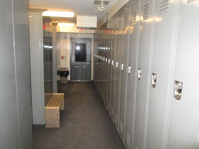 Locker room to store ski's and boots. Door leads to slope.