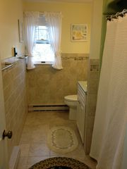 Chatham house photo - Main bath upstairs with tub/shower and nice tile accents.