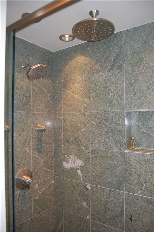 The updated downstairs bathroom comes with heated floors and a dual showerhead