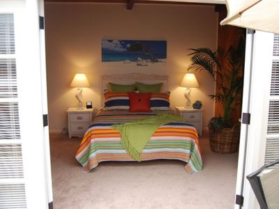 Attached guest casita with queen bed and private bath also opens to the patio