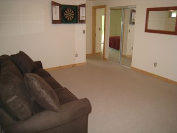 Game room with TV, DVD, PlayStation, board games and books