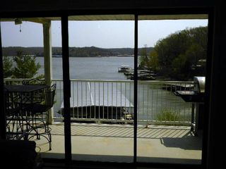 water view from great room/sliding door out to table and BBQ pit on large deck - Osage Beach villa vacation rental photo