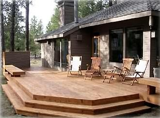 Deck with barbecue, view over meadow