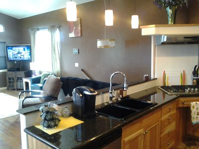 Bandon townhome rental - View shot from kitchen area. All granite counters. Gas cooktop. oven avail.