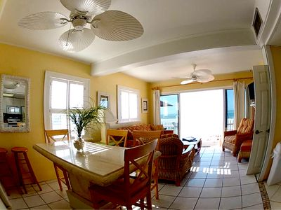 Newly furnished living room overlooking overlooking patio, beach & gulf water