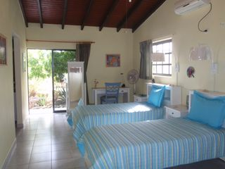 Bonaire house photo - Guestroom with twin beds, private bath and exit to pool and private gardens