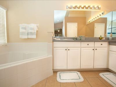 Master bath w walk in his and her closets. walk in shower stall and Soaker Tub.
