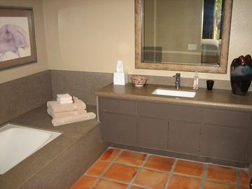 Bathroom with tub and glass enclosed shower