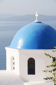 Oia villa rental - One of the many church domes you can discover while strolling in Oia