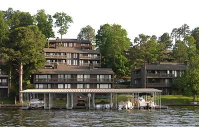 View from Lake. This unit includes a covered boat slip