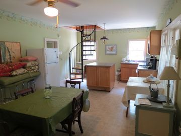 Kitchen/casual dining & spiral stair (additional access to upstairs beds & bath)