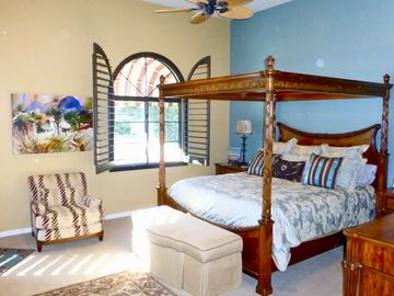 Master bedroom with king bed, f/p and seperate ensuite. Direct access to pool.