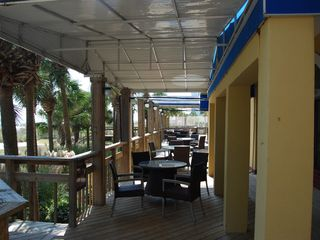 Sun n Sand Resort hotel photo - Patio and deck bar