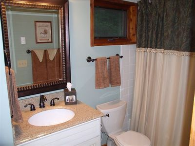 Relax in one of two elegant bathrooms...
