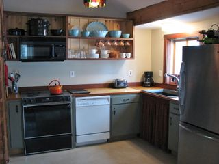 Casco cottage photo - Fully equipped kitchen overlooking deck